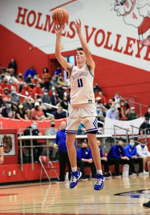 Highlands forward Luke Muller attempts a field goal in the game between Highlands and St. Henry high schools at Holmes High School March 24, 2021.