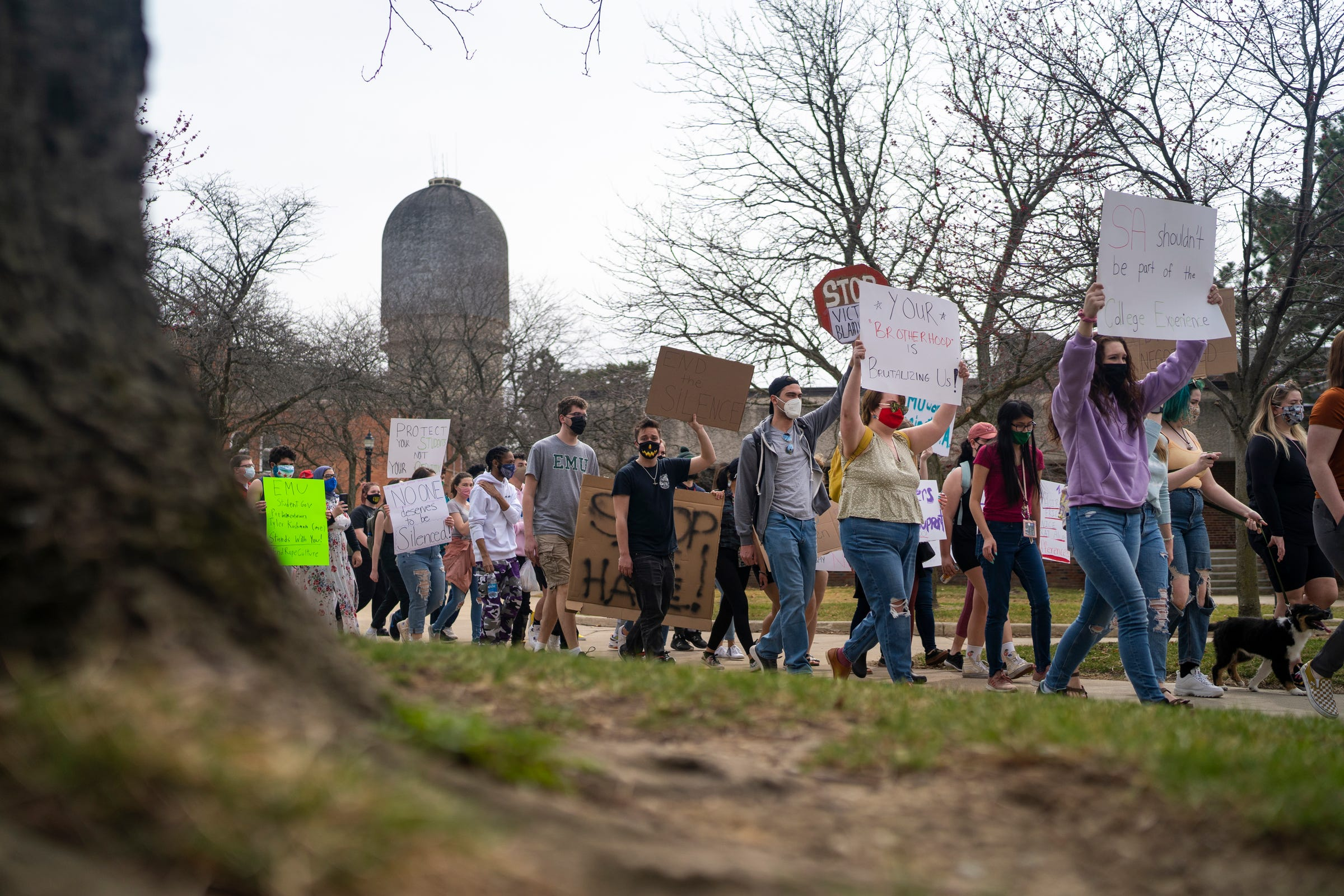 Protestors walk through campus during a march supporting sexual assault survivors in response to recent news of 11 women who filed a lawsuit against EMU at Eastern Michigan University on Thursday, March 25, 2021, in Ypsilanti. A Title IX lawsuit was filed Wednesday against the Eastern Michigan University Board of Regents and two fraternities, saying they covered up and failed to adequately address sexual assaults by several male students, according to previous Free Press reporting.