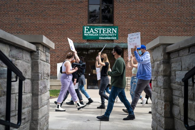 Protestors walk through campus during a march supporting sexual assault survivors in response to recent news of 11 women who filed a lawsuit against EMU at Eastern Michigan University on Thursday, March 25, 2021, in Ypsilanti. The Title IX lawsuit was filed Wednesday against the Eastern Michigan University Board of Regents and two fraternities, saying they covered up and failed to adequately address sexual assaults by several male students, according to previous Free Press reporting.