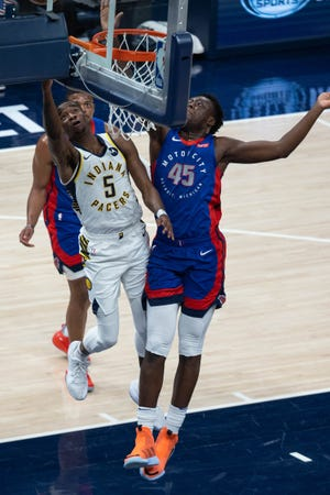 Pacers guard Edmond Sumner shoots the ball while Pistons forward Sekou Doumbouya defends during the first half on Wednesday, March 24, 2021, in Indianapolis.