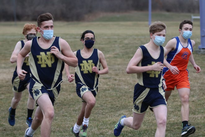 Boys runners from Elmira Notre Dame and Thomas A. Edison compete March 24, 2021 at the Murray Athletic Center in Pine Valley.