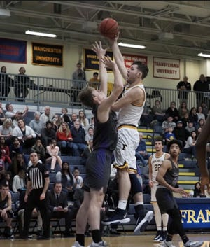 Franklin's Payton Mills shoots one of his trademark jump hooks.