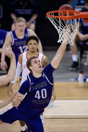 Truman State's Cade McKnight (40) lays in another two points against Flagler College during their quarterfinal game at the 2021 NCAA DII Men's Elite Eight at the Ford Center in Evansville, Ind., on Wednesday, March 24, 2021.