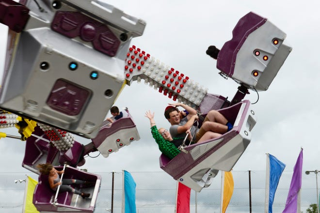 These fair visitors rode the rides at the Sandusky County Fair on Tuesday, Aug. 21, 2018. This year's fair will have rides, a full grandstand entertainment schedule and Log Cabin Stage musical performers.