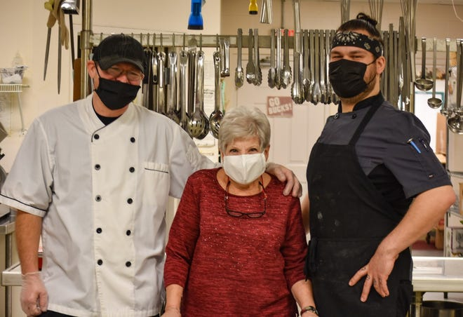 Chef Fred Downs, owner Carolyn Urbanowicz, and Chef Josh Vargas-Lloyd stand in the kitchen at Carolyn's Catering. The business' staff has agreed to work on Easter to help Elmore Church of God provide a free drive-thru lunch.