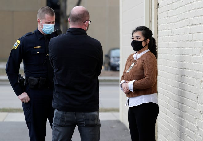 Main Oriental Market manager Tara Yang speaks outside the store with Green Bay Mayor Eric Genrich and Green Bay Police Cmdr. Kevin Warych on March 24.