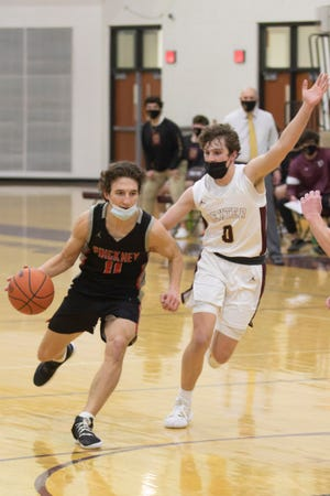 Dylan Reason (11) and his Pinckney basketball teammates had to forfeit a district semifinal game to Dexter because a player they faced Friday tested positive for COVID-19.