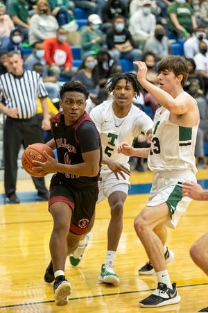 Ballard's Chaunte Marrero drives to the basket as Trinity took on Ballard at Valley High School on Wednesday evening in the 7th Region semifinals. March 24, 2021