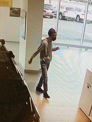 Police are searching for a suspect in an armed robbery at the Clarksville VW dealership.