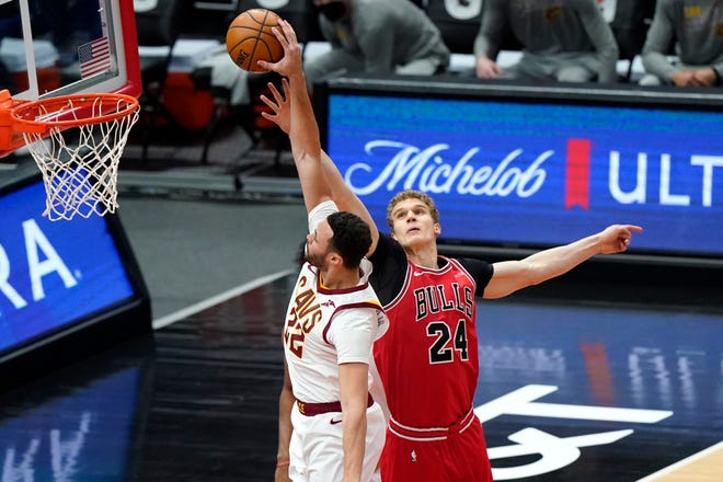 Cavaliers forward Larry Nance Jr., left, has been traded to the Portland Trail Blazers in a three-team deal including the Chicago Bulls, who sent foward Lauri Markkanen, right, to Cleveland. [Nam Y. Huh/Associated Press]