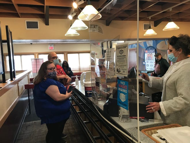 Customers were in line at 11 a.m. when Golden Corral at 575 N. Lexington-Springmill to celebrate the restaurant's grand re-opening Thursday. At the register is co-owner Renee Sears.