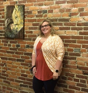 Lindsay Criswell, owner, poses inside her new art studio, Branch and Stone. The mother of three young children loves exploring different mediums to create artwork.
