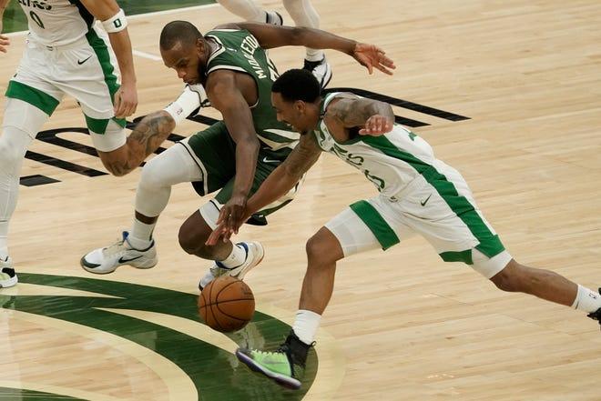 Milwaukee's Khris Middleton and Boston's Jeff Teague are now teammates with the Bucks.