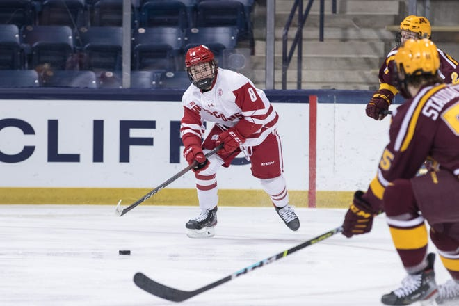 Wisconsin Badgers forward Cole Caufield has racked up 28 goals and 21 assists in 30 games and is a Hobey Baker Award finalist.