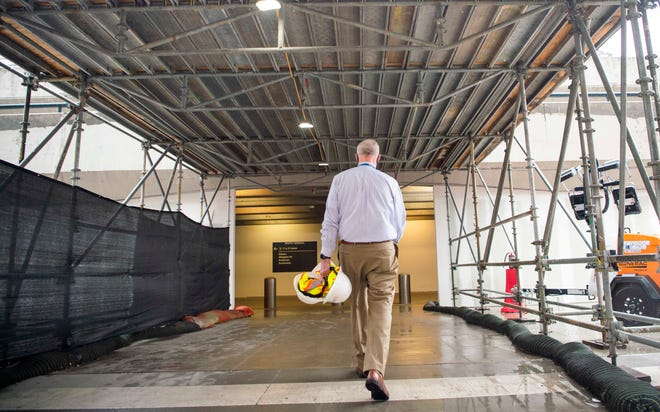Douglas Kreulen, president of the Metropolitan Nashville Airport Authority, shows improvements in the airport's central terminal as construction continues on Thursday, March 25, 2021.