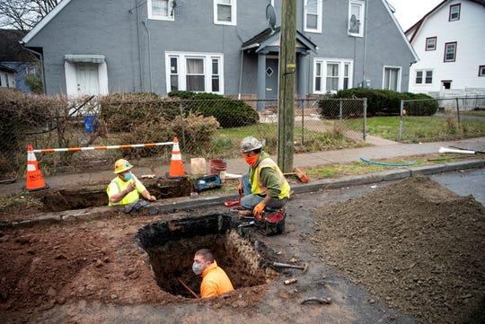 David Quatrrocchi, Fernando Silva and Jason Conklin replace lead service water lines with copper pipping leading to a home on Sanford Ave in Newark on March 24, 2021 as part of Newark's Lead Service Replacement Program.