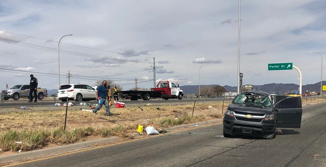 Las Cruces police investigate following a crash between a white Infinity XJ35 and a gray Chevrolet Colorado on US 70 on Thursday, March 25, 2021.
