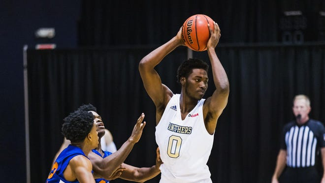 Florida International's Dimon Carrigan searches for the open man during a game in the 2020-2021 campaign.