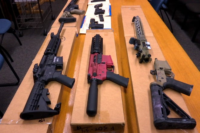 """This Nov. 27, 2019, file photo shows """"ghost guns"""" on display at the headquarters of the San Francisco Police Department in San Francisco. A proposal to ban build-your-own weapons known as """"ghost guns"""" is sparking passionate for-and-against arguments in the Nevada Legislature, just over three years after Las Vegas experienced the deadliest mass shooting in modern U.S. history. The bill introduced on Monday, March 15, 2021, would outlaw the possession and sale of homemade firearms. (AP Photo/Haven Daley, File)"""