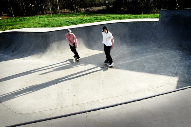 Ethan Piaskowski (cq), left, and Dakota Becerra skate at the Judy Schmidt Memorial Skate Park in Silverton. The teens are part of a fundraising effort in honor of Jason Franz that is proposed for an adjacent area.