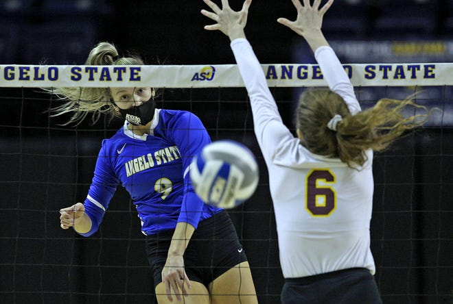 Kailyn Gilbreath, left, spikes the ball for Angelo State during a game against Midwestern State on Wednesday, March 24, 2021.