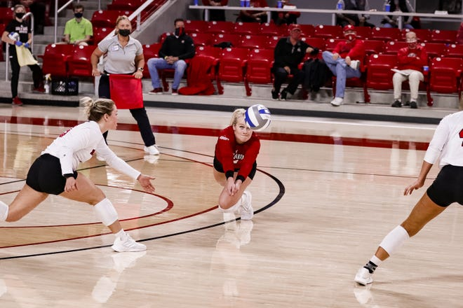 Lolo Weideman digs out a ball against Kansas City on March 19 at the Sanford Coyote Sports Center in Vermillion.