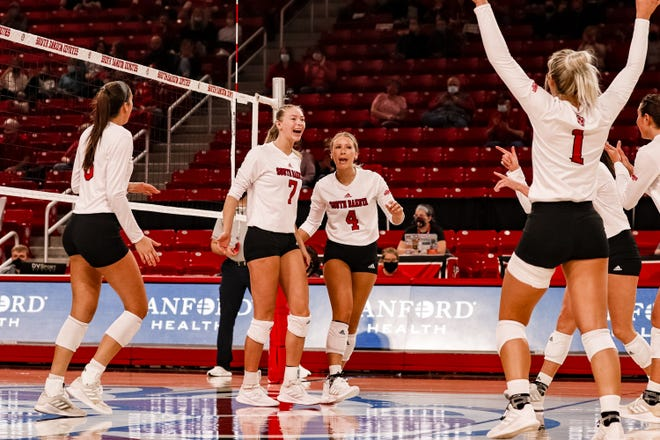 South Dakota's Madison Harms (7) celebrates a point with her teammates against Kansas City on March 19 at the Sanford Coyote Sports Center in Vermillion.