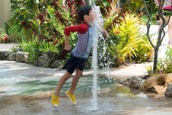 Reese Noe, 5, of Vero Beach, Florida cools off in the splash garden during the McKee Spring Break Day Camp on Thursday, March 25.