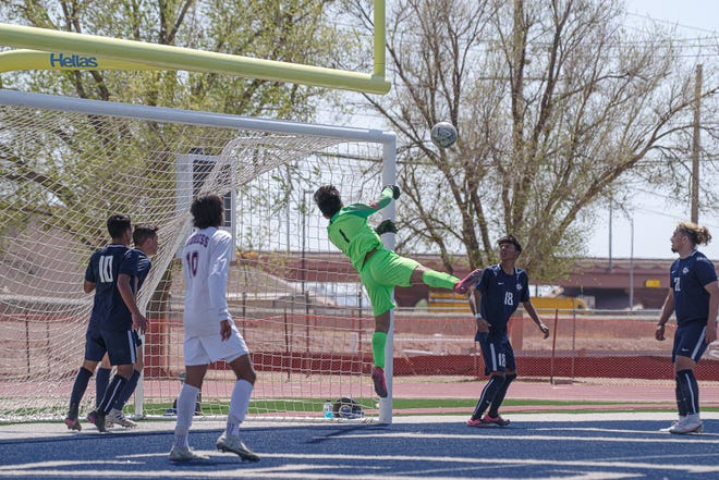 Del Valle goalie Xavier Monarrez blocks a kick. Del Valle defeated Andress High School 3-0 in varsity boys soccer to win the Class 5A Bi-District championship at Del Valle High School on March 25, 2021.