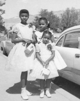 Congresswoman Barbara Lee (left) as a child in El Paso on Mother's Day in 1957 with her two younger sisters Mildred Whitfield, and Beverly Hardy.
