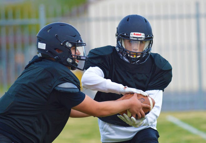 The Woodlake High School football team practices on March 17, 2021 in Woodlake.