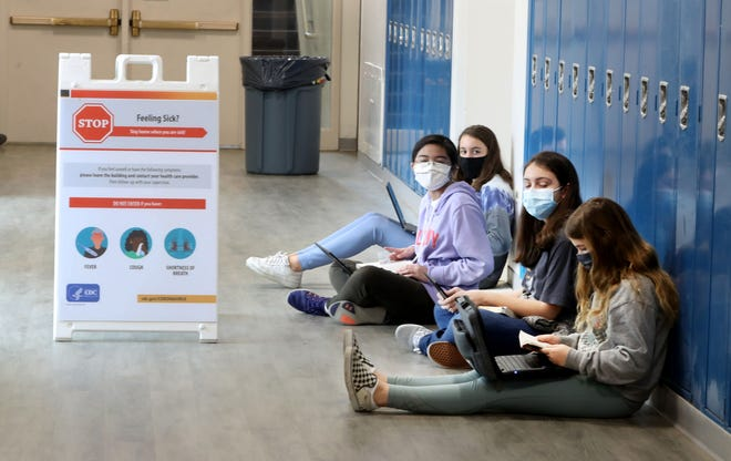Students at Rye Middle School work in a hallway March 25, 2021. Most Rye school students are back in school full time after almost a year of hybrid learning during the COVID-19 pandemic.