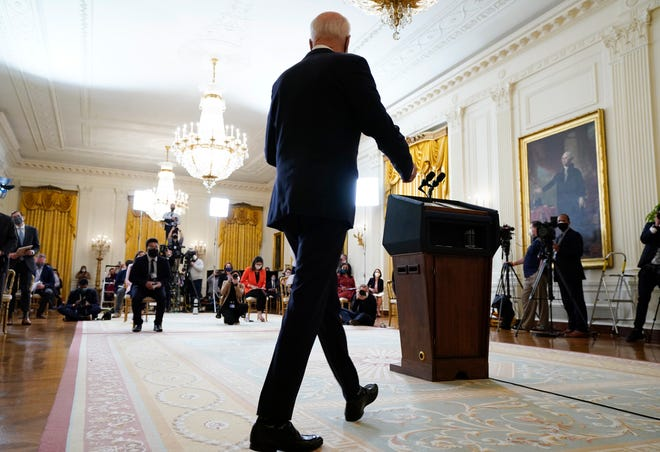 President Joe Biden arrives to speak during his first press conference as president in the East Room of the White House on Thursday.