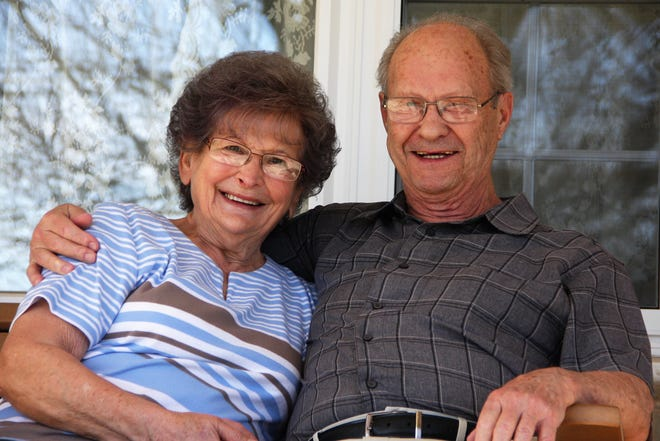 Nancy and Ronald Peiffer pose for a photo on the porch of their home in Jonestown, Lebanon County, on March 12.