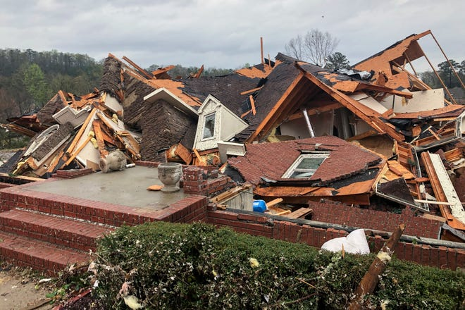 Damage is seen to a home after a tornado passed through the Eagle Point subdivision, Thursday, March 25, 2021, near Birmingham, Alabama.