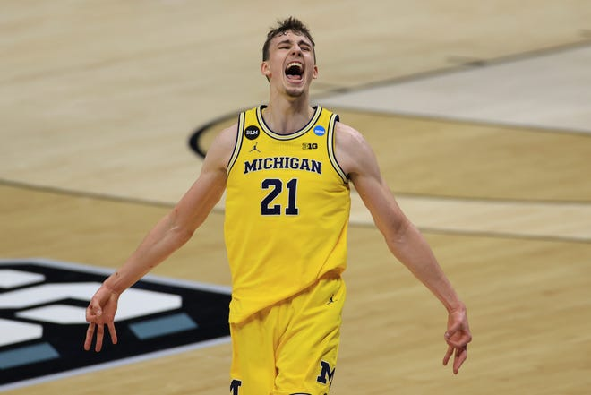 Michigan Wolverines guard Franz Wagner (21) celebrates after a three-point basket during the second half in the second round of the 2021 NCAA Tournament against the Louisiana State Tigers at Lucas Oil Stadium.