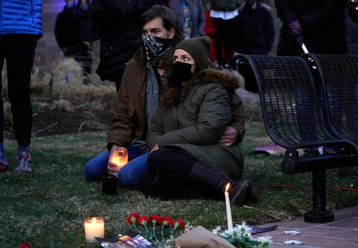 Mourners attend a vigil for the victims of a mass shooting at a grocery store earlier in the week, Wednesday, March 24, 2021, outside the courthouse in Boulder, Colo.