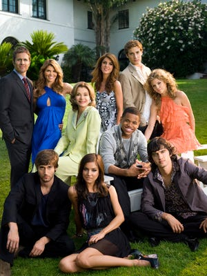 """AnnaLynne McCord (right) with her """"90210"""" cast members, front row, left to right: Ryan Eggold as Ryan, Jessica Stroup as Silver, Michael Steger as Navid; middle row, left to right: Jessica Walter as Tabitha, Tristan Wilds as Dixon, AnnaLynne McCord as Naomi; back row, left to right: Rob Estes as Harry, Lori Loughlin as Debbie, Shenae Grimes as Annie, Dustin Milligan as Ethan."""