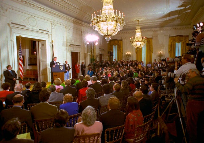 In this March 23, 1993, photo, members of the media fill the East Room of the White House during President Bill Clinton's first formal news conference since taking office.