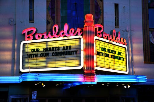 The marquee sign at the Boulder Theater pays tribute to the 10 killed in Monday's shooting at a King Soopers grocery store in Boulder, Colo.