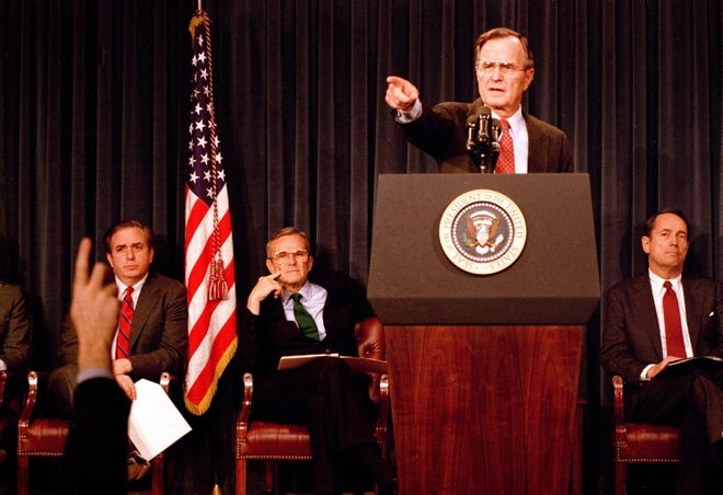 President George H.W. Bush points to a reporter during a news conference on Feb. 6, 1989 — likely his second formal one — at the Old Executive Office Building to unveil a plan to bail out this nation's savings and loan institutions.
