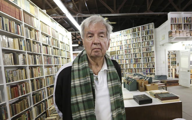 """Pulitzer Prize-winning author Larry McMurtry poses at his bookstore in Archer City, Texas. McMurtry has died at the age of 84. His death was confirmed Friday, March 26, 2021, by a spokesman for his publisher Liveright. Several of McMurtry's books became feature films, including the Oscar-winning films """"The Last Picture Show"""" and """"Terms of Endearment."""" He also co-wrote the Oscar-winning screenplay for """"Brokeback Mountain."""" (AP Photo/LM Otero, File)"""