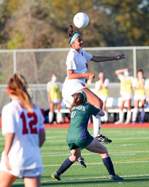 Sofia Guerrero leaps into the air and heads the ball downfield  for Lake Travis during a Class 6A bidistrict playoff game that Lake Travis won 4-1 Thursday at McNeil High School.