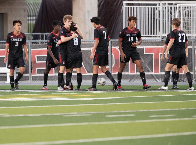 Lake Travis players congratulate Alex Bethke, No. 9, after one of his three goals during a 4-2 win by Lake Travis over Stony Point in a Class 6A bidistrict playoff game March 25 at Cavalier Stadium.