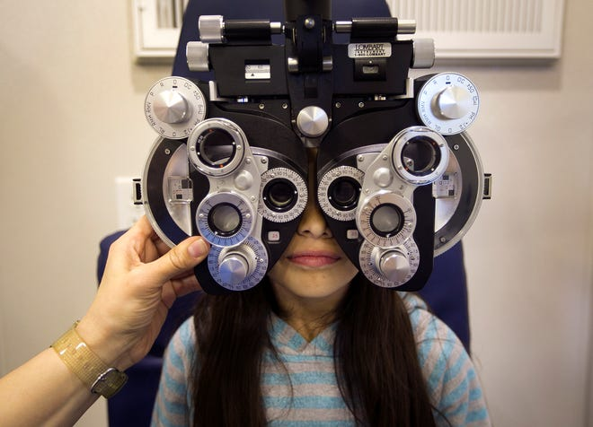 Melanie Pardo, a second-grader at Perez Elementary, had her eyes examined at the Kids Vision for Life Central Texas mobile vision clinic in 2014. [DEBORAH CANNON / AMERICAN-STATESMAN / FILE]