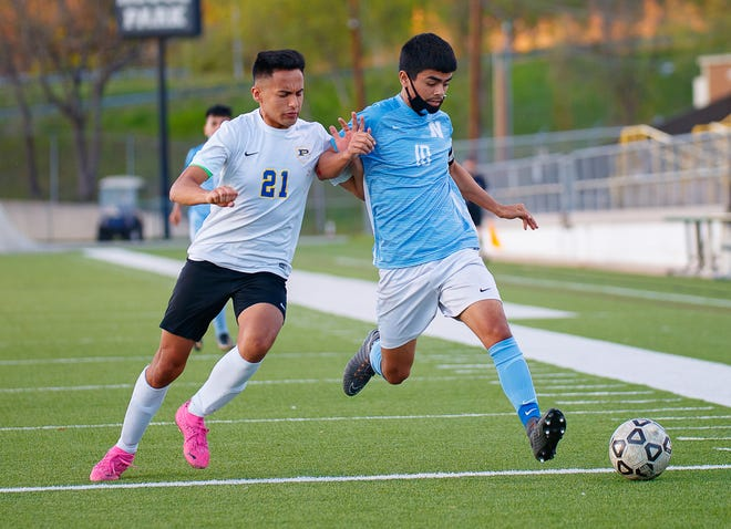 Northeast's Areli Garcia dribbles the ball away from Pflugerville's Maximilian Montellano during the second half at the Class 5A bidistrict boys soccer playoff game on March 25 at House Park. Garcia, a four-year starter and Northeast's team captain, scored the winning goal in the Raiders' 2-1 victory, their first playoff win in seven years.