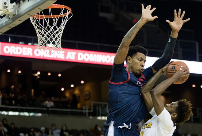 Northern Kentucky Norse guard Trevon Faulkner (12) draws a foul Illinois-Chicago Flames forward Braelen Bridges (23) in the second half of the NCAA mens basketball game on Sunday, Feb. 16, 2020 at BB&T Arena in Highland Heights, Ky. Illinois-Chicago Flames defeated Northern Kentucky Norse 73-43.