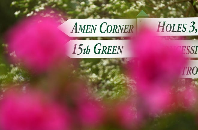 Apr 6, 2019; Augusta, GA, USA; Amen Corner sign through the azaleas and dogwood tree blooms near the 6th green during the final round of the Augusta National Women's Amateur golf tournament at Augusta National GC. Mandatory Credit: Rob Schumacher-USA TODAY Sports