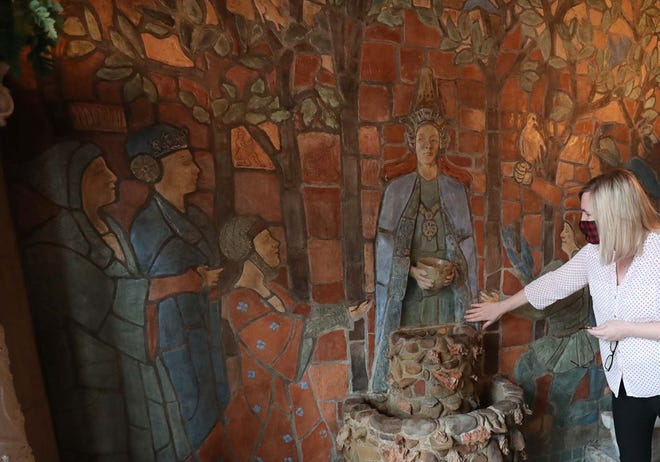 Julie Frey, curator at Stan Hywet Hall & Gardens in Akron, points out restoration to the original tile work on the fountain in the West Porch of the Manor House as part of a $6.2 million project.