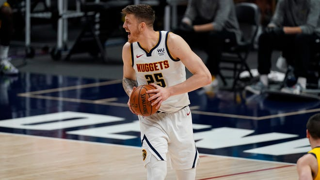 Isaiah Hartenstein (25), acquired in a trade with the Denver Nuggets, will bring toughness and energy to the Cavaliers according to coach J.B. Bickerstaff. [David Zalubowski/Associated Press]